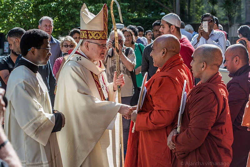 Archbishop greets Buddhist Monks after memorial service