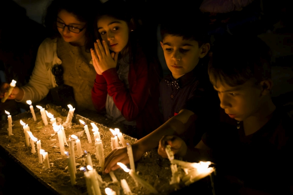 Christian Iraqi children light candles