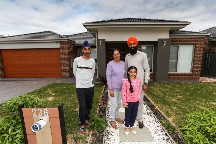 The Sandhu family out front their brick Bendigo home.