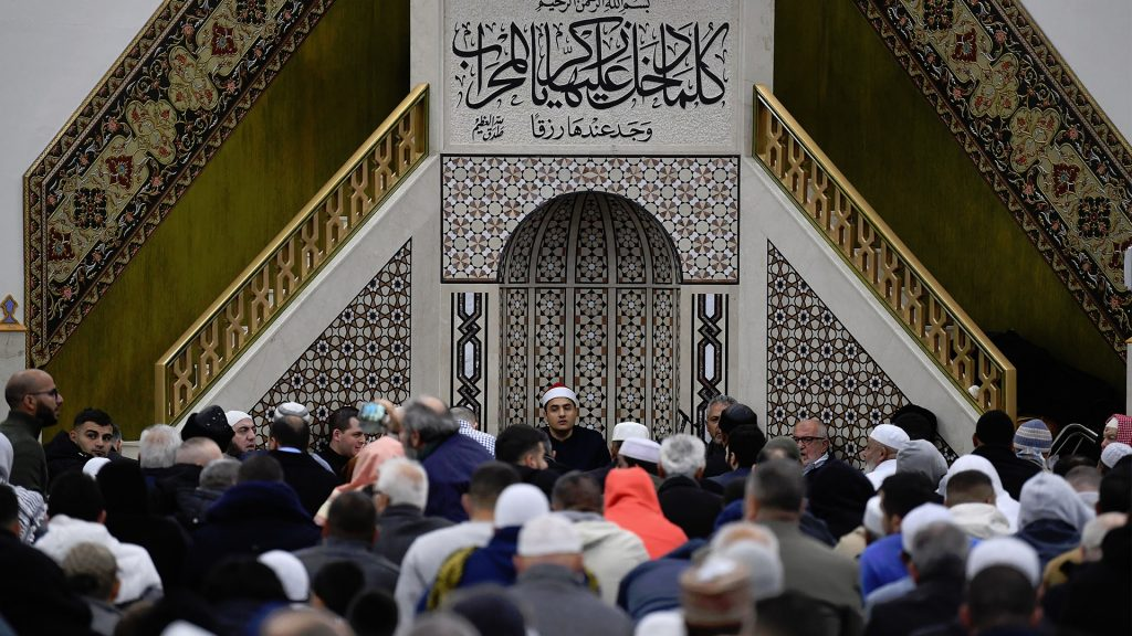 Members of the Muslim community at Lakemba Mosque
