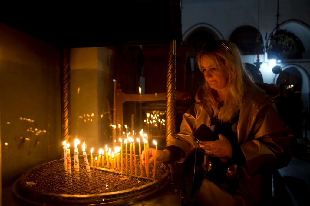 Lighting candles at nativity - Bethlehem
