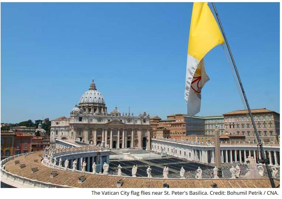 Vatican flag flies above St Peters