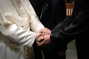 shaking hands with the pope