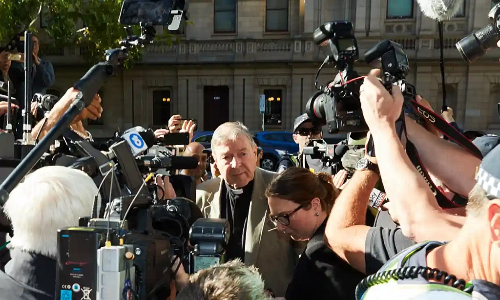 Cardinal Pell in a media throng as he enters court, Melbourne
