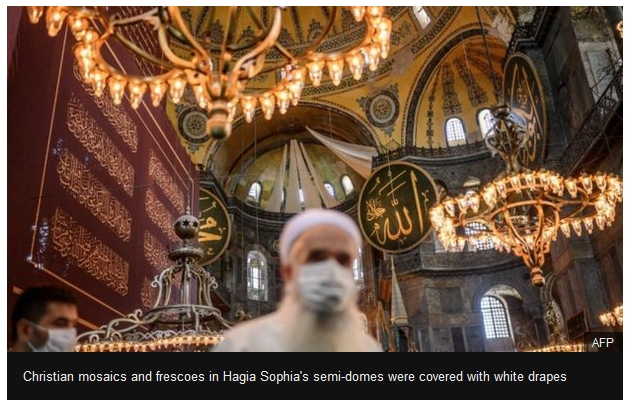 mosaics and frescoes in Hagia Sophia's semi-domes were covered with white drapes.
