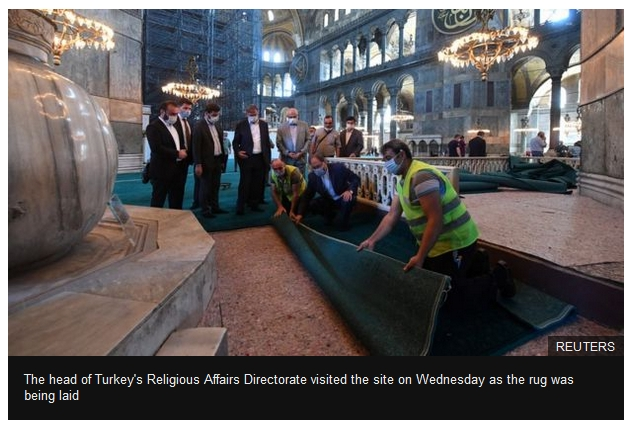 A turquoise carpet had been laid on the floor to prepare for prayers