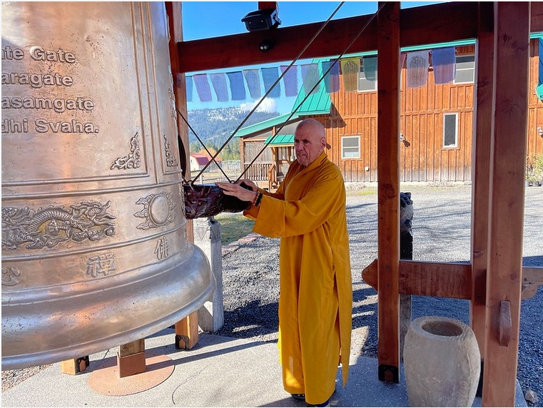 A Buddhist monk tolls the Bell for Sacred People, Sacred Earth