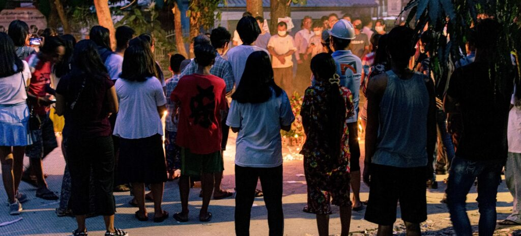 People holding a vigil in Yangon, Myanmar.